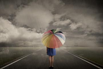 Woman Walking Alone On Rainy Day