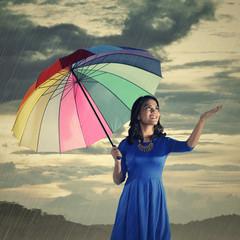 Woman Check If The Rain Stop