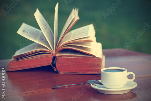 Coffee and book on wooden table-vintage filter - 82893359