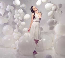Beautiful brunette beauty on balloon background