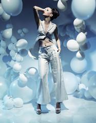 Fashion shot of a brunette woman among balloons