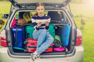 Summer vacation, young girl ready for travel
