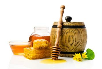 Honey in wooden barrel with honeycomb