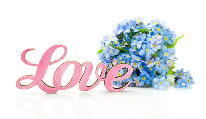 "Forget-me-not flowers and word ""love"""
