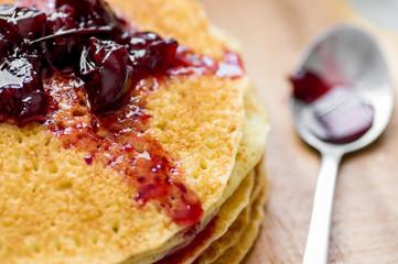 Cherry jam on blini - pancakes