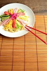 Hiyashi chuka with red chopsticks