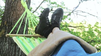 Men's legs in hammock