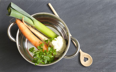 Raw vegetables pot and spoon love cooking concept