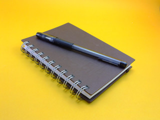 notebook on yellow background
