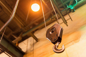 Close up of factory hoist in a fabrication hall