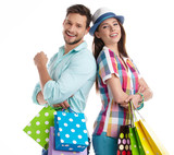 Attractive young couple holding shopping bags on white backgroun
