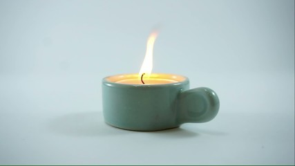 candle burning in the ceramic holder