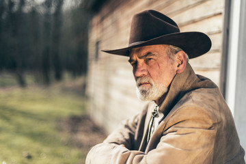 Sitting Pensive Senior Western Man Looking Afar