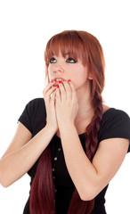 Worried teenage girl dressed in black with a piercing