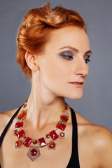 red-haired girl with chiseled cheekbones