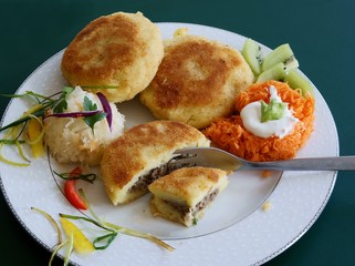 potato collops with meat filling and vegetable salad