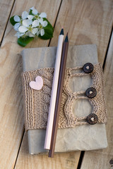 Old vintage notepad Knitted sweater in beige, heart from felt an