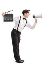 Young movie director shouting on a megaphone