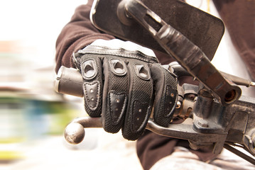 Biker hand rests on the steering wheel motorcycle