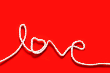"""The word """"love"""" written with rope"""