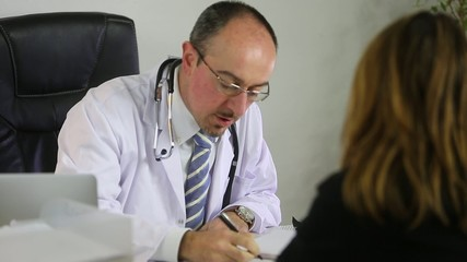 A doctor is explaining a prescription to a patient