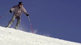 Beautiful Slow Motion Of Skier Carving Down Fast With Snow Spraying Behind