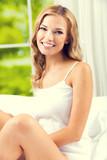 Young beautiful smiling woman waking up