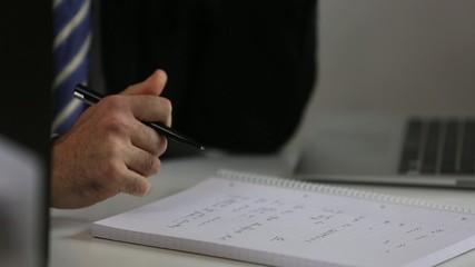 Businessman's hand writing