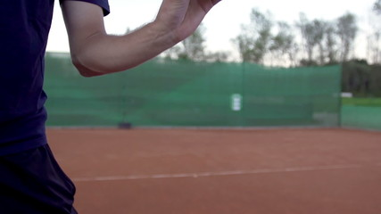 Slow Motion Of Tennis Player Throwing And Catching The Tennis Ball