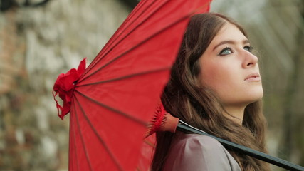 Close Up Of Beautiful Fashion Model Spinning Traditional Red Japanese Umbrella