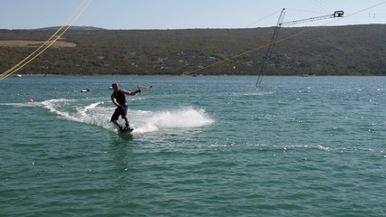 Slow-Mo: Muscular Wakeboarder Slicing The Water To Make Splash