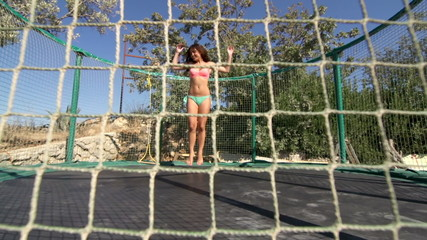 Slow-Mo: Fit Young Woman Having Fun While Jumping On The Trampoline