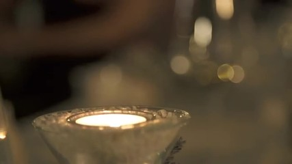 Candle Glowing In Front Of Gleamy Flared Background