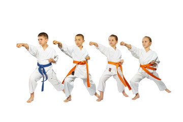 Children with different belts are training high punch