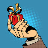 Fototapety gift in his hand a small box pop art comics retro style Halftone