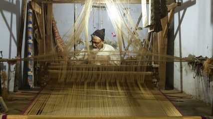 varanasi, india, indian weaver at work