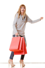 girl in full length with red shopping bags isolated