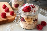 Fototapety Breakfast overnight oats with raspberries and coconut in a jar
