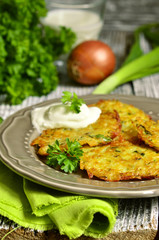 Potato fritters with cheese, green onion and herbs.