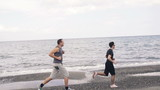 Two man jogging on the beach