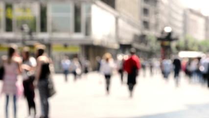 People walking on the street,de focused