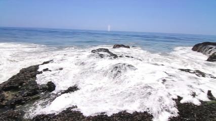 Surf's Up Malibu, Quick camera pan as waves crash onto rocks.