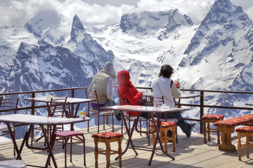 Girls are in an alpine cafe