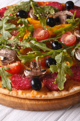 Delicious pizza with herbs, vegetables and salami vertical