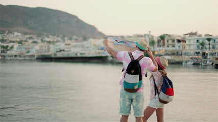 Boy and girl are traveling to Greece