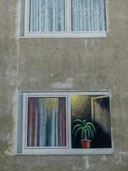gemalener Balkon auf einer Hauswand