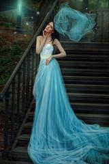 Fairy  blue long dress of a fairy tale.