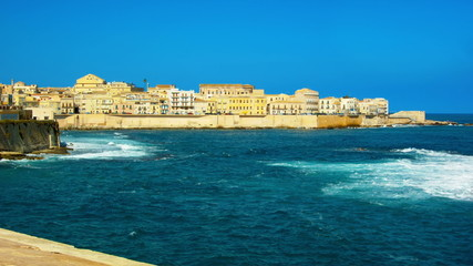 Old town surrounded by deep blue mediterranean sea