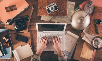 Messy vintage desktop with laptop