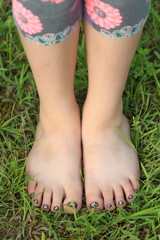 Close-up view of little shoeless girl toes on feet